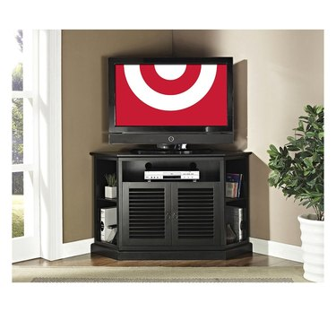 Black corner TV unit with open shelving on each side