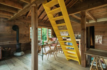 cabin interior with yellow ladder