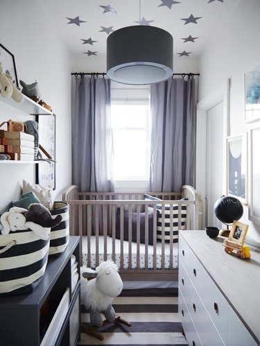 gray, white, and blue nursery idea with striped rug and stars on ceiling