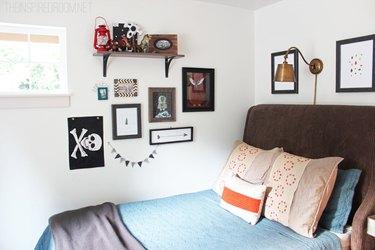 teen boy's bedroom with gallery wall