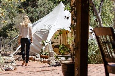 A tent hidden in a sunny backyard