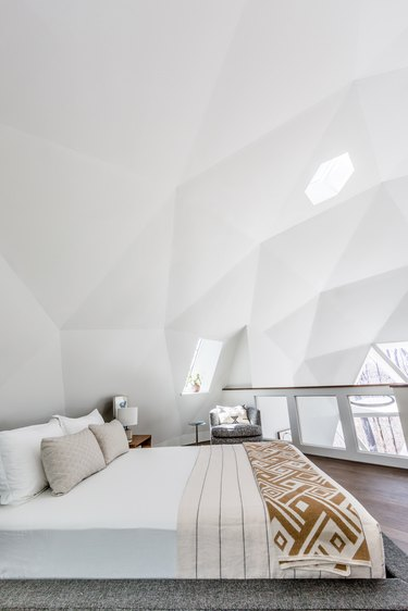 lofted white bedroom in dome house