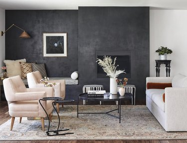 living room with a dried floral arrangement on the coffee table