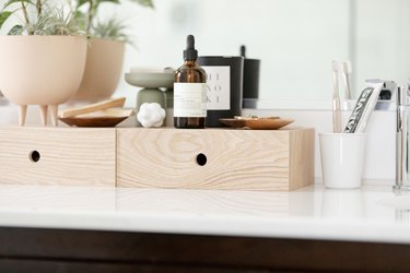 bathroom decor idea with wooden boxes on countertop for essentials