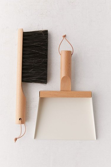 brown and white dustpan and brush set