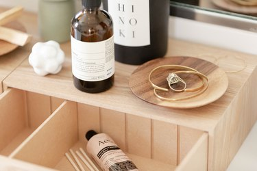 bathroom decor idea with wooden box on countertop to store daily essentials
