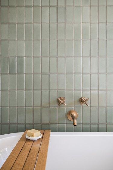 light green ceramic tile on the bathroom wall