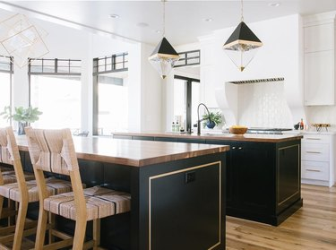 large open kitchen with two black islands
