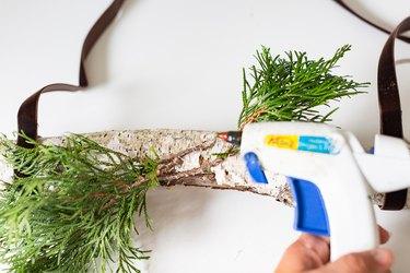Glueing greenery with hot glue