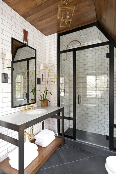 Slate tile floors in an industrial style bathroom