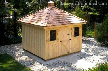Shed with hipped roof.