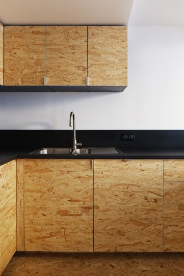 Black, white and exposed wood create contrast