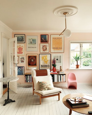 pink living room with gallery wall and modern furniture