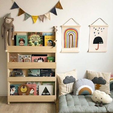 Scandinavian kids bedroom idea with floor cushion reading area