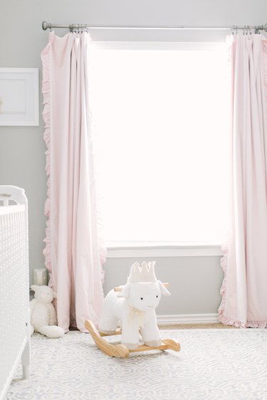 pretty pink and gray nursery idea with pink drapery and white crib