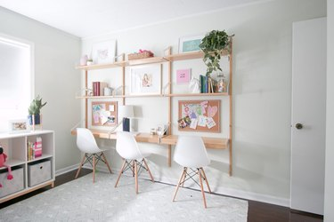 IKEA kids' bedroom idea wall-mounted desks with midcentury chairs