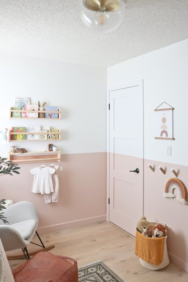 pink and white nursery idea with color blocking and flush mount ceiling fixture