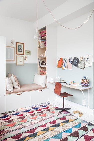 IKEA kids' bedroom idea pink and white reading nook with colorful patterned rug