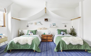 Modern kids' bedroom ideas with green bedspreads, a canopy, and rustic decor