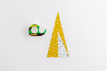 Slip the two paper shapes together and tape.