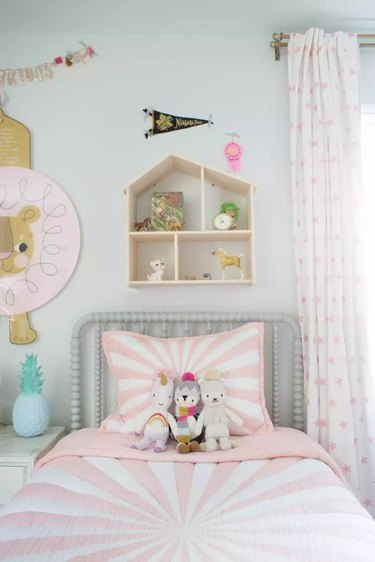 IKEA kids' bedroom idea with doll house wall shelf, pinks, and whites