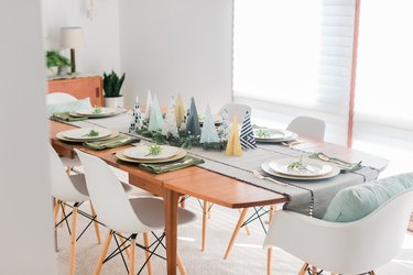 Style the rest of the table with other holiday décor that matches your trees' color palette.