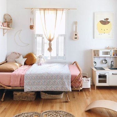 IKEA kids' bedroom idea with play kitchen and neutral color palette with pops of pink