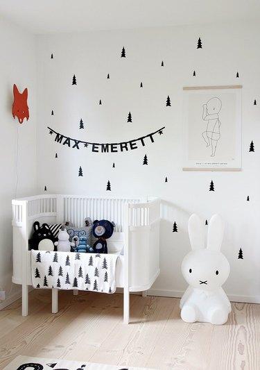 Scandinavian nursery idea with black-and-white tree pattern