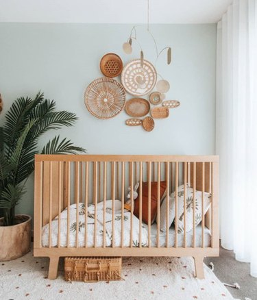 bohemian baby nursery idea with mint green walls with basket art