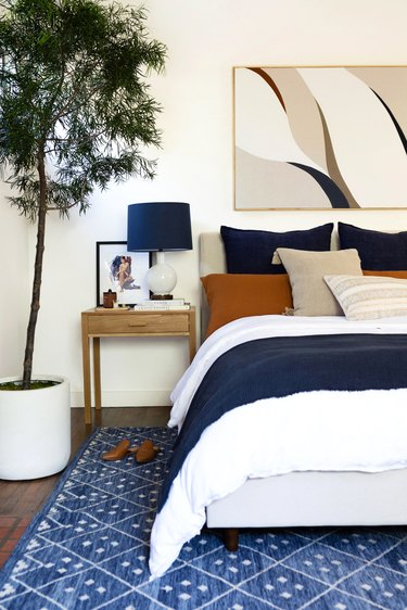 bedroom with navy, white, and rust color palette