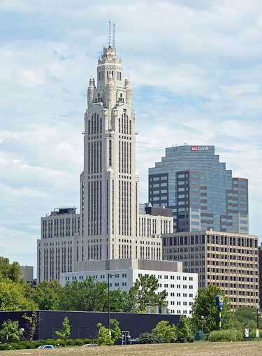 LeVeque Tower in Ohio seen from a distance with buildings nearby