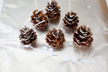 Pine cones on foil paper.