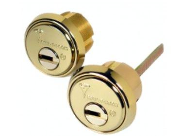 A pair of door lock cylinders.