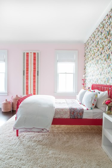 teen bedroom idea for girls with pink bed frame and patterned wallpaper with pink walls