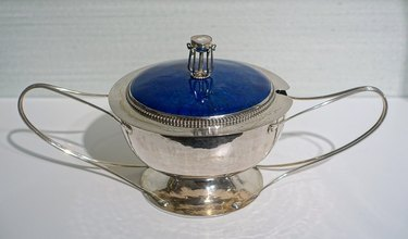 silver and blue covered bowl