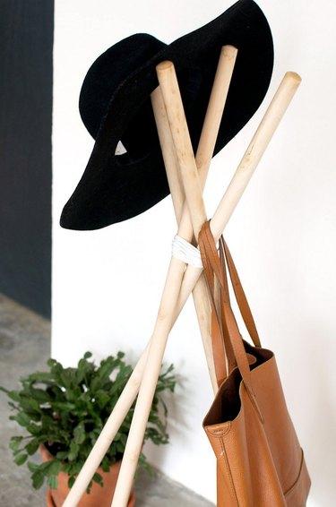 hat stored on coat rack