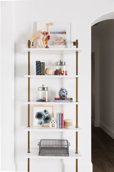 playroom storage idea with art supplies in glass canisters