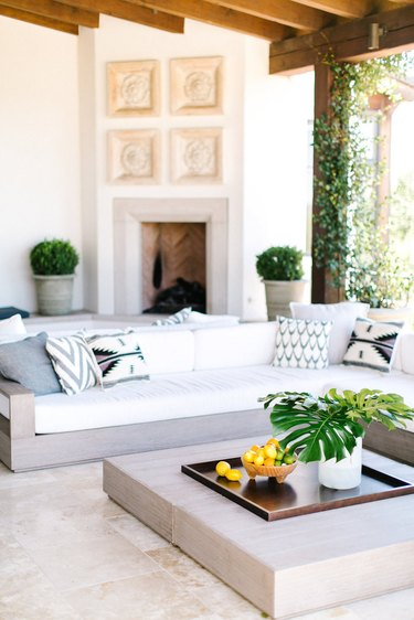outdoor living room with sectional sofa and coffee table