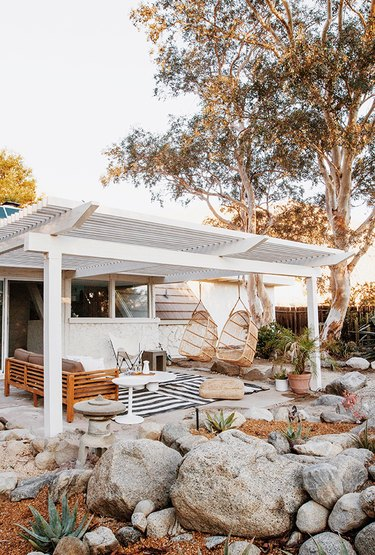 backyard structure with hanging chairs