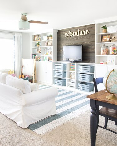 blue and white playroom storage idea with painted crates for concealed storage