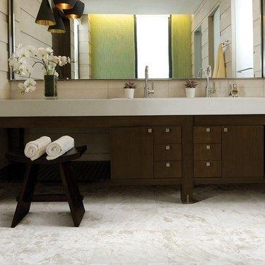 A bathroom with sheet vinyl flooring