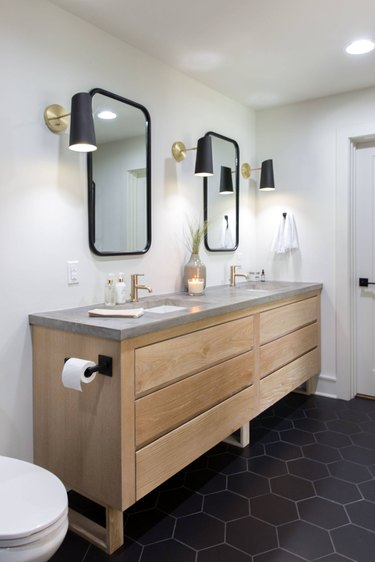 bathroom with concrete countertop and wood vanity