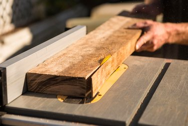Cutting hardwood with a table saw.
