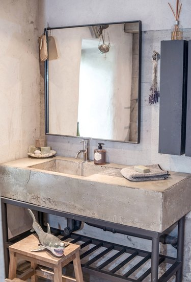 bathroom with concrete countertop