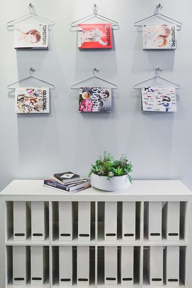 magazines stored on clothing hangers