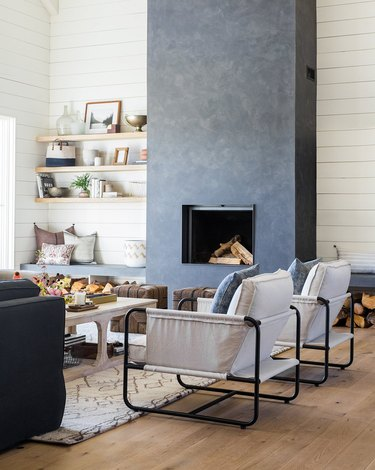 farmhouse living room with concrete fireplace and shiplap walls