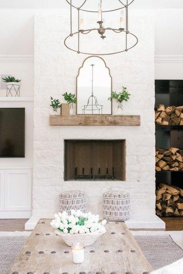 all-white farmhouse fireplace