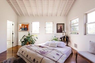 Bedroom with lavender bedspread
