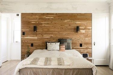 Boho bedroom with wood wall