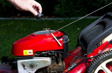 Checking the oil in a lawn mower.